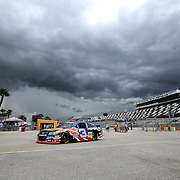 Austin Dillon returns to the garage area after the first practice session of the 56th Annual NASCAR Coke Zero 400 race at Daytona International Speedway on Thursday, July 3, 2014 in Daytona Beach, Florida. A thunderstorm moved in and delayed the practice session. (AP Photo/Alex Menendez)