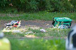 ©Licensed to London News Pictures 26/06/2020<br /> Orpington, UK. Trainers and a first aid kit. Coronavirus lockdown is over and crime is back on our streets. A gang of six youths on bikes have attacked a man in Orpington,South East London this afternoon. Police, paramedics and the London Air Ambulance attended the scene to find a man with head injuries and covered in blood. Photo credit: Grant Falvey/LNP