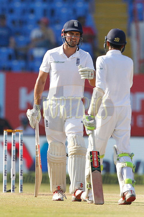 Alastair Cook Captain of England celebrates his Fifty with Haseeb Hameed of England during day 5 of the first test match between India and England held at the Saurashtra Cricket Association Stadium , Rajkot on the 13th November 2016.<br /> <br /> Photo by: Deepak Malik/ BCCI/ SPORTZPICS