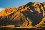 Folded landscape rises from dry pampa , evening light, La Quinta estancia on edge Parque Nacional Los Glaciares, Patagonia, Argentina.