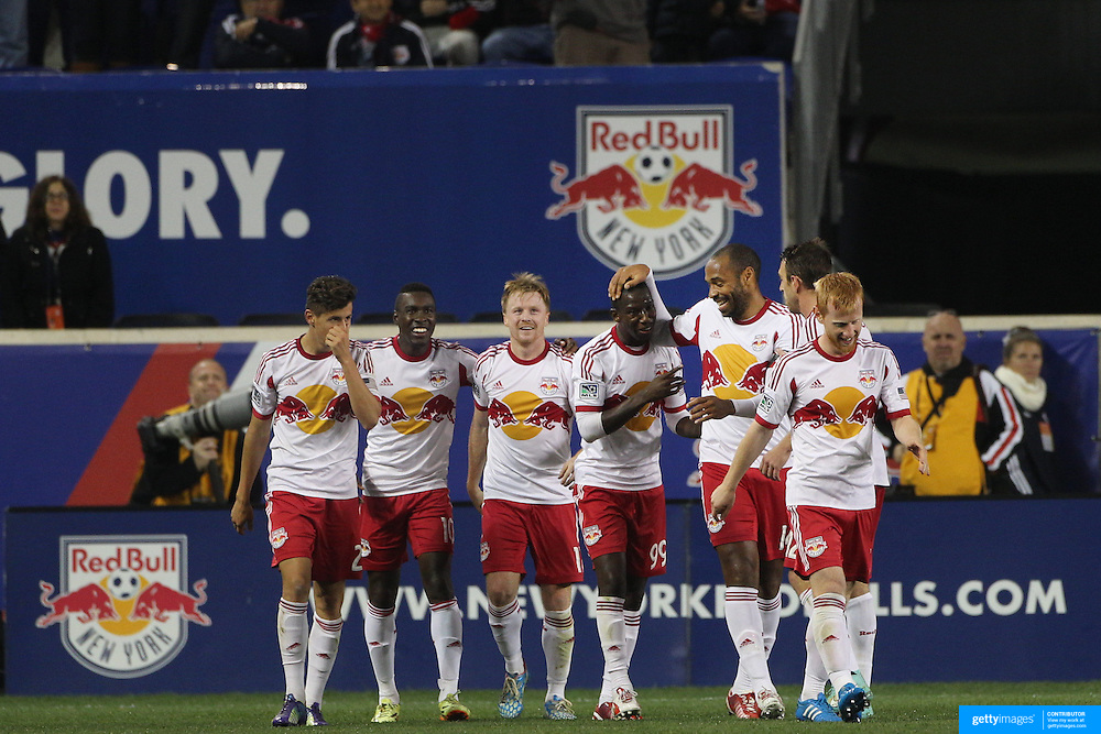 Thierry Henry, New York Red Bulls, congratulates Bradley Wright-Phillips for his assist which led to a goal by Dax McCarty during the New York Red Bulls Vs Toronto FC, Major League Soccer regular season match at Red Bull Arena, Harrison, New Jersey. USA. 11th October 2014. Photo Tim Clayton