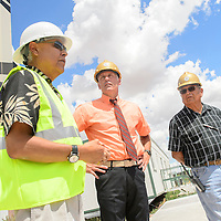070815  Adron Gardner/Independent<br /> <br /> Hayes Lewis, Zuni public schools district superintendent, left,  Tom Graves, and Ricky Penketewa survey construction of a new elementary school in Zuni Wednesday.