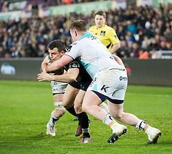 Ospreys' Tom Habberfield is tackled by Connacht's Conor Carey<br /> <br /> Photographer Simon King/Replay Images<br /> <br /> Guinness PRO14 Round 19 - Ospreys v Connacht - Friday 6th April 2018 - Liberty Stadium - Swansea<br /> <br /> World Copyright © Replay Images . All rights reserved. info@replayimages.co.uk - http://replayimages.co.uk