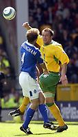 Fotball<br /> England 2004/2005<br /> Foto: SBI/Digitalsport<br /> NORWAY ONLY<br /> <br /> Norwich v Birmingham<br /> FA Barclays Premiership<br /> 07/05/2005<br /> <br /> Norwich's Dean Ashton gets ahead of  Birmingham's Kenny Cunningham