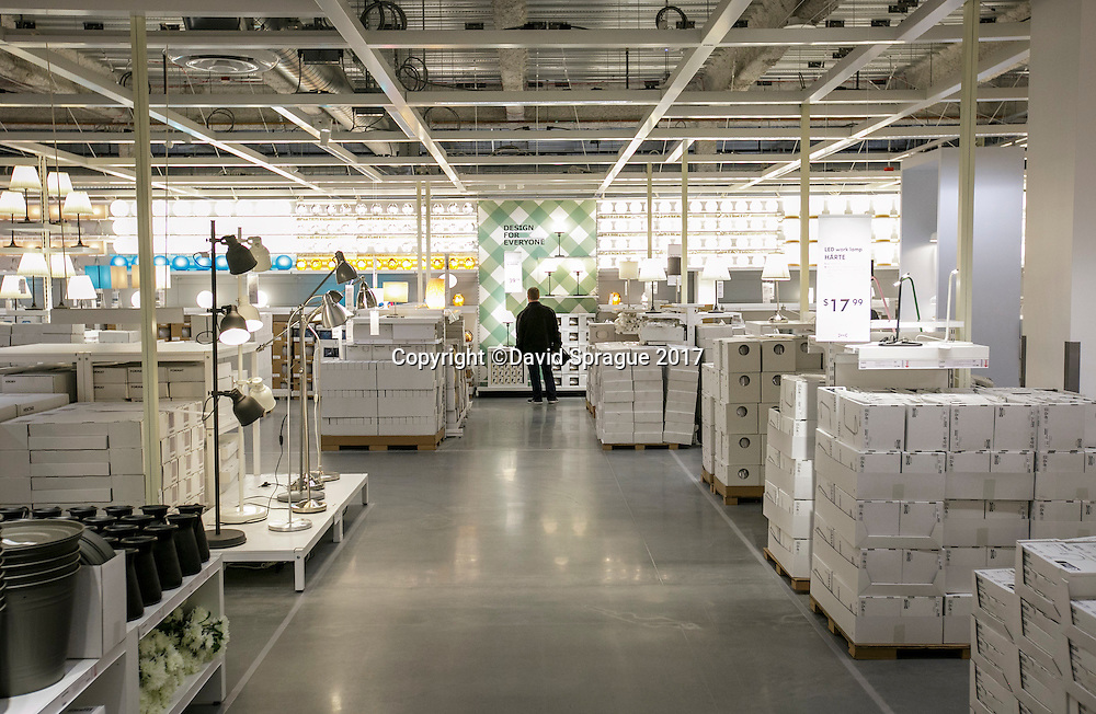 A man shops solo for lighting at the grand opening of the new Ikea in Burbank. The new Ikea store comes in at 456,000 sf, compared to the old one at 242,000 sf. And 1,700 parking places.  Feb. 8, 2017  Photo by David Sprague
