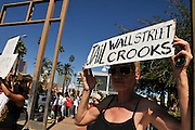 """Maggie Smith, (left, along with about 1,000 demonstrators, participates in Occupy Tucson at Military Plaza in Armory Park, Tucson, Arizona, USA.  The Occupy Tucson organizers created the movement in solidarity with the Occupy Wall Street movement in New York and the Occupy Together movement across the USA. ..The leaders of this movement are the everyday people participating in a movement with many de-centralized goals, with an over-arching theme of protesting government corruption from corporate money and national income disparity. We use a tool called the """"General Assembly"""" to facilitate open, participatory and horizontal organizing between members of the public. We welcome people from all colors, genders and beliefs to participate in our movement. .."""