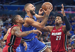 October 17, 2018 - Orlando, FL, USA - The Orlando Magic's Evan Fournier, middle, drives between the Miami Heat's Rodney McGruder, left, and Hassan Whiteside (21) at the Amway Center in Orlando, Fla., on Wednesday, Oct. 17, 2018. (Credit Image: © Stephen M. Dowell/Orlando Sentinel/TNS via ZUMA Wire)