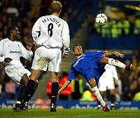 Photo. Chris Ratcliffe, Digitalsport<br /> Chelsea v Bolton. FA Premiership. 13/12/2003<br /> Adrian mutu tries an acrobatic shot on goal as bruno n'gotty and per frandsen watch on