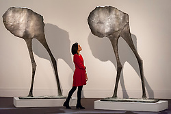 """© Licensed to London News Pictures. 18/11/2016. London, UK. A staff member views """"Mirage II"""" by Dame Elisabeth Frink (est. GBP120-180k)"""", at the preview at Sotheby's of works on view at four upcoming November auctions featuring Modern & Post-War British Art, A Painter's Paradise (Julian Trevelyan & Mary Fedden at Durham Wharf), Scottish Art and Picasso Ceramics from the Lord & Lady Attenborough Private Collection. Photo credit : Stephen Chung/LNP"""