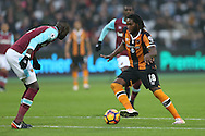 Dieumerci Mbokani of Hull City ®  looks to go past Cheikhou Kouyate of West Ham United. Premier league match, West Ham Utd v Hull city at the London Stadium, Queen Elizabeth Olympic Park in London on Saturday 17th December 2016.<br /> pic by John Patrick Fletcher, Andrew Orchard sports photography.