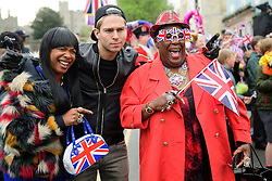 ©  London News Pictures. 21/04/2016. Windsor, UK. SANDY CHANNER (left) and SANDRA MARTIN (right) from Gogglebox, with Joey Essex (centre) outside Windsor Castle ahead of a walkabout by HRH Queen Elizabeth II  in the town of Windsor, Berkshire on the day of her 90th birthday.  Queen Elizabeth is currently the longest serving monarch of the UK, having served for over 60 years. Photo credit: Ben Cawthra/LNP