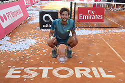 May 6, 2018 - Estoril, Portugal - Joao Sousa of Portugal poses with the trophy after winning the Millennium Estoril Open ATP 250 tennis tournament final against Frances Tiafoe of US, at the Clube de Tenis do Estoril in Estoril, Portugal on May 6, 2018. (Credit Image: © Pedro Fiuza via ZUMA Wire)