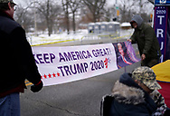 Supporters of U.S. Republican presidential candidate Donald Trump hang a banner outside a Trump rally site in Des Moines, Iowa, January 29, 2020. The supporters arrived the day before the rally to sleep outdoors to be sure to get into the event.   REUTERS/Rick Wilking