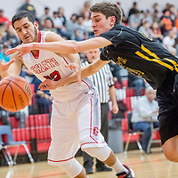 Grants Pirate Adrian Sanchez (32), left, and St. Pius X Sartan Zachary Kolkmeyer (24) vie for a loose ball at Grants High School Thursday.