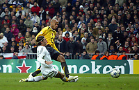 Photo: Chris Ratcliffe.<br />Real Madrid v Arsenal. UEFA Champions League. 2nd Round, 1st Leg. 21/02/2006.<br />Thierry Henry of Arsenal scoring the first goal.