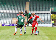 Sunderland Defender Denver Hume (33) is on the ball  and attacking while under pressure  from Plymouth Argyle Midfielder Joe Edwards (8) and Plymouth Argyle Forward Panutche Camará (28) during the EFL Sky Bet League 1 match between Plymouth Argyle and Sunderland at Home Park, Plymouth, England on 1 May 2021.