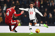 Derby County midfielder Tom Ince (10) takes a shot at goal with Cardiff City defender Sean Morrison (4) closing in during the EFL Sky Bet Championship match between Derby County and Cardiff City at the Pride Park, Derby, England on 14 February 2017. Photo by Jon Hobley.