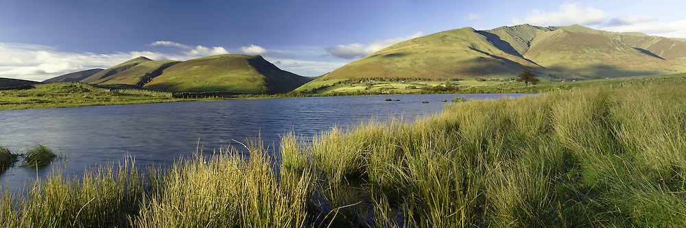 Tewet Tarn with Skiddaw and Blencathra in the background, Lake District, Cumbria, Uk