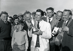 Gary Player of South Africa, holds up the trophy after his win in the Open golf championship.
