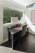 House, modern interiors, sunny studio of artist, desk and chair