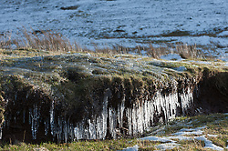 © Licensed to London News Pictures. 16/02/2016. Hay Bluff - Brecon Beacons National Park, Powys, Wales, UK. Icicles are seen at Hay Bluff - near Hay-on-Wye - in the Eastern sector of the Brecon Beacons (The Black Mountains) in Powys, Wales, UK. Snow which fell a week ago still lies on the summits of the Brecon Beacons. Temperatures this morning are several degrees centigrade below zero but with the moderate wind the 'feels like' temperature is around minus 5 - 8 degrees centigrade. Photo credit: Graham M. Lawrence/LNP