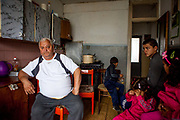 "In the flat of family Matouci in one of the highrise buildings at Lunik IX. Two families are living in this flat, father Matouci explains: ""I worked for 37 years and got educated under the totalitarian regime where everybody had to work. Nowadays nobody likes to give us work because of the color of our skin. Since the Velvet Revolution 1989 none of our governments we had tried to solve the Roma issue (question). My son left for the UK with his family - where he also works - after he was attacked by a bunch of skinheads who almost killed him."" The family left Lunik IX for the UK where the are living till now."
