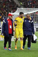 ROMANIA, Bucharest : Romania's Cristian Tanase (C) is injured during the Euro 2016 Group F qualifying football match Romania vs Northern Ireland in Bucharest, Romania on November 14, 2014.