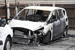 © Licensed to London News Pictures. 26/07/2019. Chessington, UK. The remains of a burnt out car have been discovered in Epsom, south west London after a man died in a hit and run incident late last night in Moor Lane Chessington. Police were called to a car in collision with a man on Moor Lane in Chessington at 00:13hrs on Friday, 26 July. The driver did not stop and the man was dragged under the car for some distance. Emergency services arrived an the man, believed to be aged 25 years, was pronounced dead on Moor Lane. Police believe they know the man's identity and his next of kin have been informed. Formal identification and a post-mortem examination will be arranged in due course. There has been no arrest. Enquiries are underway to establish the full circumstances. Photo credit: Peter Macdiarmid/LNP