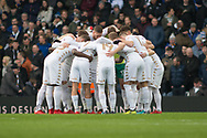 Leeds huddle together before the start of the EFL Sky Bet Championship match between Leeds United and Millwall at Elland Road, Leeds, England on 20 January 2018. Photo by Craig Zadoroznyj.