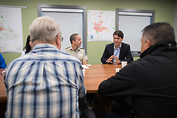 Prime Minister Justin Trudeau, back right, speaks as B.C. Fire Protection Officer Tom Reinboldt, back left, listens during a meeting with British Columbia Wildfire Service staff and other officials during a visit to the Prince George Fire Centre, in Prince George, B.C., on Thursday August 23, 2018. Photo by Darryl Dyck/CP/ABACAPRESS.COM