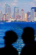 NEW YORK, NY: Passengers on the Staten Island Ferry look toward the new Manhattan sky line, without the imposing World Trade Center towers, Sept. 21, 2001. Terrorists crashed two hijacked jetliners into the World Trade Center collapsing the towers on Sept 11, 2001, killing more 2,900 people.   PHOTO BY JACK KURTZ