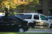 Dallas police patrol at the apartment complex where a third Ebola patient lives in Dallas, Texas on October 15, 2014. (Cooper Neill for The New York Times)
