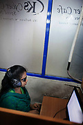 Dhaka, Bangladesh. A cyber cafe near Dhaka University. Zannat is a sociology students at Eden Women's College and she is blind.  She comes to the cyber cafe to go online, surf and check her mails. The cafe has one terminal which is set up with software which reads out all actions and all text, a service CSID has provided for. The Stars Foundation visiting CSID. Centre for Services and Information on Disability (CSID) is a charity working for integrating disabled children into mainstream society.