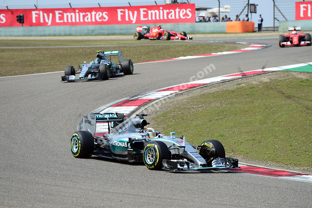 Lewis Hamilton leads Mercedes team-mate Nico Rosberg and other cars during the 2015 Chinese Grand Prix at the Shanghai International Circuit. Photo: Grand Prix Photo