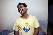 Pravesh Verma, 29, from the charity MASVAW, is smiling inside his home in Lucknow, Uttar Pradesh, India. Pravesh grew up in a middle class family living in a small village where women had to stay in the house and cover their faces when young or just married. He never helped with anything at home; sometimes he and his brother used to beat their sister when she left home to be with her local friends. He used to insult girls using foul language. He had a girlfriend, an adult relationship, but nobody was to know. When his father found out, they had to break up. He later moved to Lucknow in 2001 to study philosophy, and in summer 2007 he attended his first MASVAW-workshop on gender equality. He was impressed and continued to visit those kind of workshops in the coming years. Pravesh began to change; he started to cook and clean on his own, opened up a banking account for his sister where he could deposit some money for her, he even asked his father to change some of his property to his mother's name. He now has a girlfriend named Pinki, 29, and they both met each other's parents. He would like to marry her, but she is still thinking about it. She lives close to Delhi, and they can only meet twice a month. He resides in Lucknow with his sister and his old grandmother, around 100 years old.