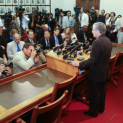 Images from 2003's Democratic walkout in the Texas House from May 12-13, 2003 during the 78th session of the Texas Legislature include House Speaker Tom Craddick holding a press conference.