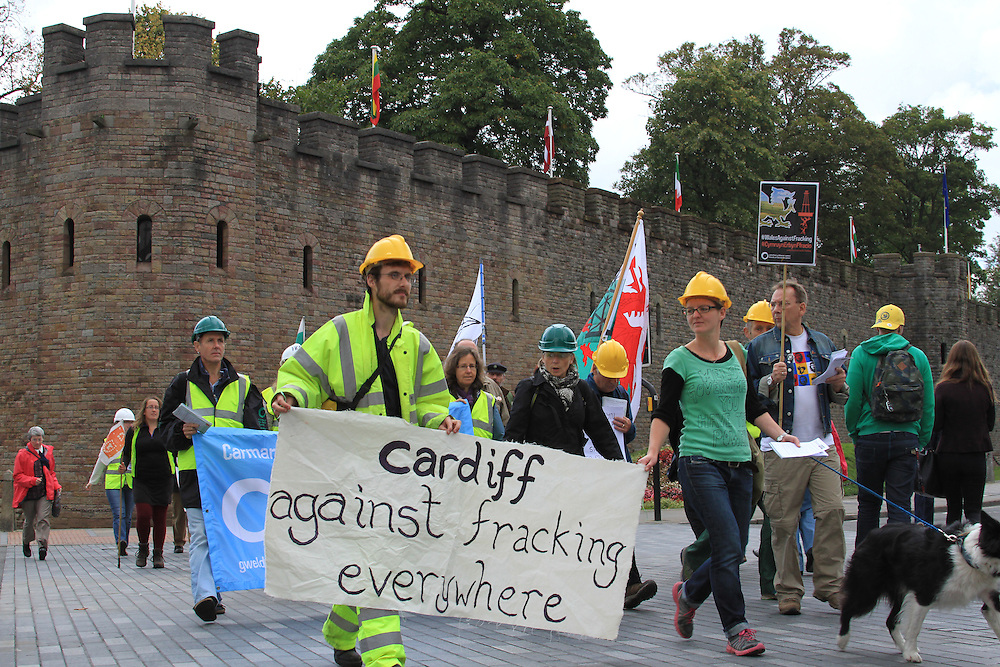 Frack Free Wales protesters march from Cardiff Castle to Y Senedd as part of Global Frackdown Day to highlight the environmental dangers of tracking
