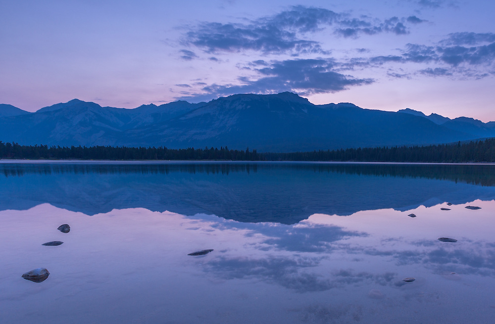 Night descends over the waters of Lake Edith in Jasper National Park.