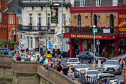 "© Licensed to London News Pictures. 03/07/2020. London, UK. Heavy traffic in Barnes Village in South West London as pub goers enjoy a takeaway beer at the Watermans Arms next to the River Thames before ""Super Saturday"" after Prime Minister Boris Johnson gave the go ahead in his statement to the Nation last week. Photo credit: Alex Lentati/LNP"