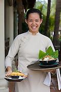 Evason Ana Mandara & Six Senses Spa ? Nha Trang. Waitress bringing food at the Beach Restaurant.