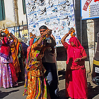 Asia, India, Udaipur. Devotees carry vessels of water.