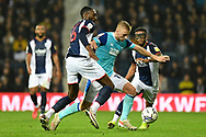 West Bromwich Albion defender Semi Ajayi (6)battles for possession with Derby County midfielder Louie Sibley (17) during the EFL Sky Bet Championship match between West Bromwich Albion and Derby County at The Hawthorns, West Bromwich, England on 14 September 2021.