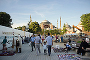 A flea market outside the Hagia Sofia in Istanbul, originally built by Emperor Justinian stood as the largest world cathedral for more than a thousand years, before being converted into a mosque and, now, a museum...Istanbul 7 June 2012
