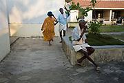 Vadivelu, 75 does an impromptu dance with one of the female residents, Tamaraikulum Elders village, Tamil Nadu, India