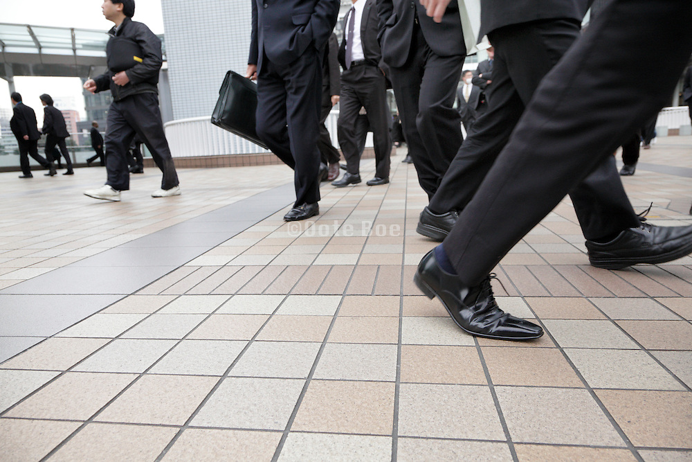 low point view of business people walking