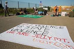 West Hyde, UK. 14th September, 2020. Environmental activists from HS2 Rebellion use lock-on arm tubes to block a gate to the South Portal site for the HS2 high-speed rail link. Anti-HS2 activists blocked two gates to the same works site for the controversial £106bn rail line, one remaining closed for over six hours and another for over nineteen hours.