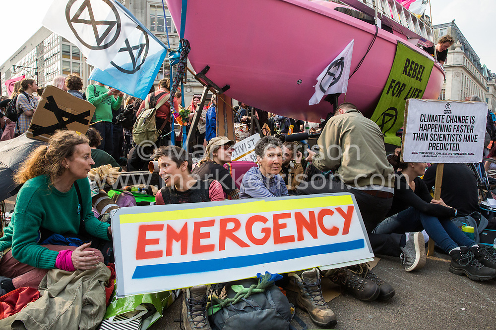 London, UK. 17th April 2019. Climate change activists from Extinction Rebellion, some of whom locked onto the Ship of Truth, continue to occupy Oxford Circus on the third day of International Rebellion activities.