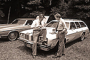 Carter and Mondale get away from the crowd for a private<br /> talk while attending a church picnic at Plains Baptist.