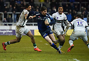 Sale Sharks full-back Simon Hammersley hands off London Irish centre Curtis Rona and cuts inside full back Tom Parton during a Gallagher Premiership Rugby Union match won by Sharks 39-0, Friday, Mar. 6, 2020, in Eccles, United Kingdom. (Steve Flynn/Image of Sport)