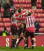 Photo. Glyn Thomas.<br /> Sunderland v Burnley. Nationwide Division 1.<br /> Stadium of Light, Sunderland. 29/11/03.<br /> Sunderland players mob Kevin Kyle after he gave his side a 1-0 lead going into half time.